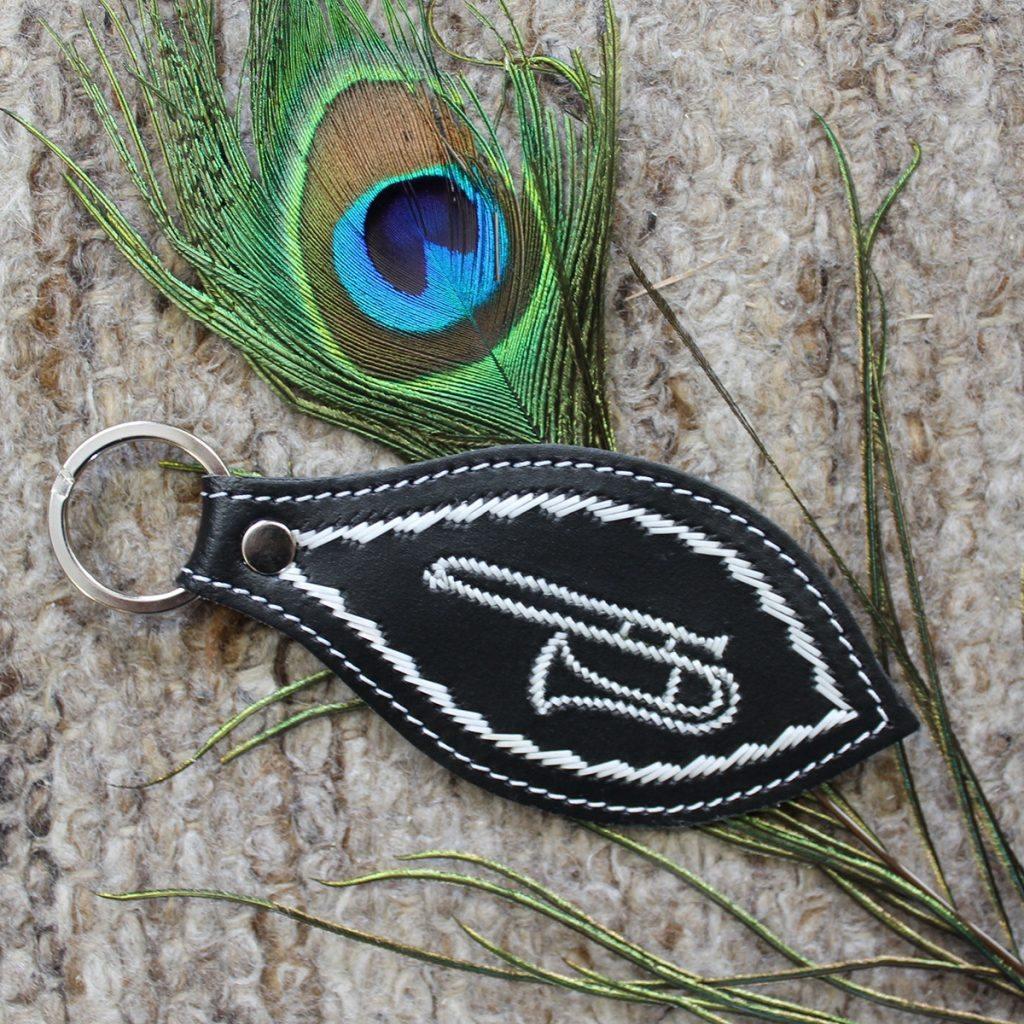 Schlüsselanhänger mit Zugposaune